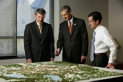 John Affleck-Graves with University architects reviewing campus 3D model